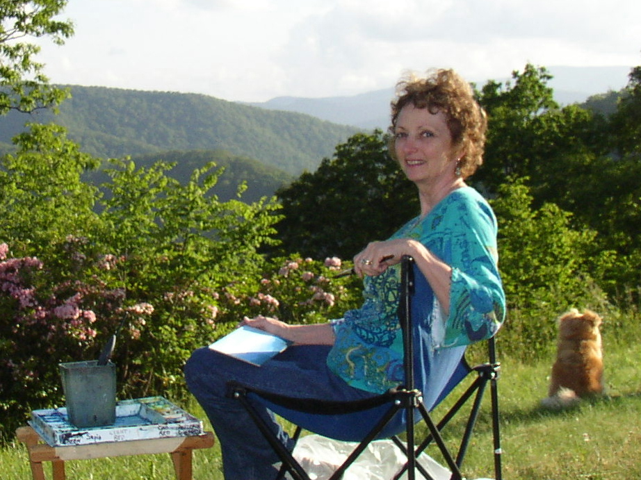 Photo of Sharyn Fogel Painting Outdoors on a Hilltop